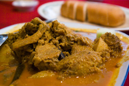 ... this curry lamb was served with a loaf of bread.